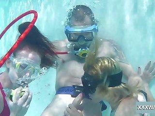 Babes take coils sucking Hawkshaw underwater and they are ergo hazardous