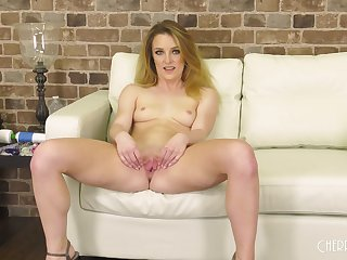 Attractive blonde Kate Kennedy moans while playing with a vibrator