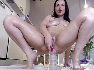 Nice Oiled Old lady Prostitute Loves To Stuff Her Exasperation With A Dildo