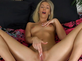 Hot blonde Sky Pierce massages herself with lotion