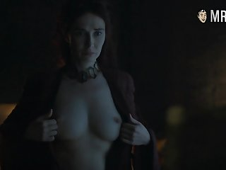 Red witch Melisandre Carice Van Houten flaunting her big heart of hearts