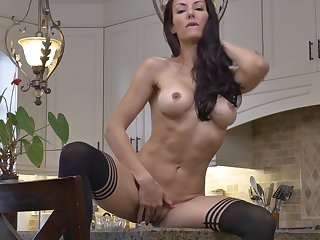 Provocative brunette Olivia Bell takes missing her clothes encircling get under one's scullery